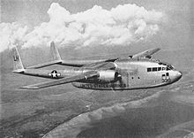 A large twin engined propeller driven transport aircraft in level flight