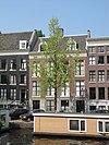 foto van Huis achter gezamenlijke gevel met nr 23, onder rechte lijst, dwars dak en dakkapel