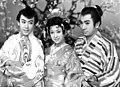Raizō Ichikawa, Ayako Wakao and Shintarō Katsu in Hatsuharu Tanuki Goten 1959.jpg