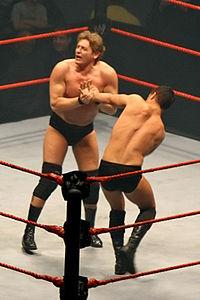 Regal applies a wrist lock to Cody Rhodes