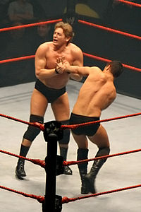 Regal applies a wrist lock to Cody Rhodes
