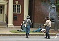 Resisting men are shot after the battle of corydon reenactment.jpg