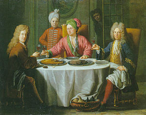 Drinking culture - Reunion of gentlemen around a table in an interior by Jacob van Schuppen.