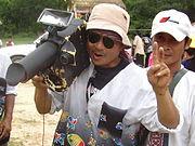 Rocket Festival Cameraman Salutes