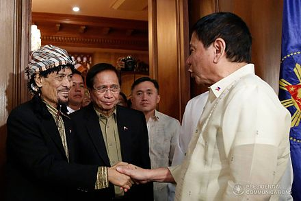 Duterte meeting with MNLF chairman, founder and former ARMM Governor Nur Misuari, November 3, 2016 Rodrigo Duterte welcomes Nur Misuari in Malacanang.jpg