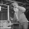 Rohwer Relocation Center, McGehee, Arkansas. In repairing a piece of farm machinery, Chester Ishii . . . - NARA - 539384.tif