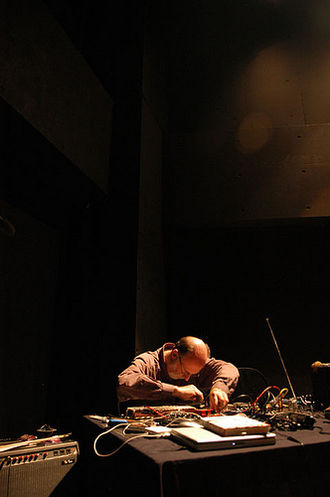 Live electronic music - Keith Rowe (pictured in 2008) improvising with prepared guitar at a music festival in Tokyo.