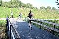 Running woman on small bridge triathlon.jpg