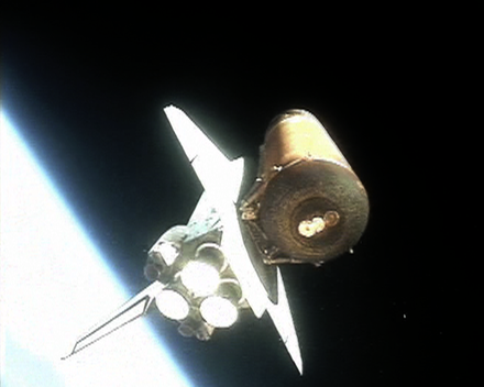 Discovery attached to the external tank immediately after solid rocket booster (SRB) separation SRBsepfromDiscovery07042006.png