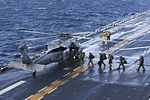 Sailors and Marines aboard USS Bataan prepare to board an MH-60S Sea Hawk helicopter. (32519145165).jpg