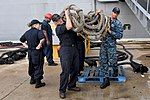 Sailors from USS Iwo Jima loads supplies prior to the ship getting underway. (30108629311).jpg