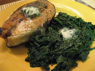 Beurre Maître d'Hôtel - A salmon steak with Beurre Maître d'Hôtel, served with spinach