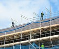 Scaffolders above the roof of the Victoria Dock development - geograph.org.uk - 374663.jpg