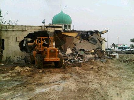 A loader destroying the 400-year-old Amir Mohammed Braighi mosque in A'ali Sheikh Mohammed al-Barbaghi Mosque being demolished.jpg