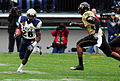 Shun White carries the ball at 2008 EagleBank Bowl 081220-N-0923G-003.jpg