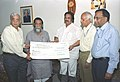 Sibu Soren receiving a dividend cheque from the CMD Neyvelli Lignite Corporation, Shri S. Jayaraman, in New Delhi on March 22, 2006. The Minister of State for Coal Shri Dasari Narayana Rao is also seen.jpg