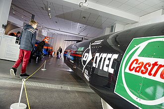 Side view of Thrust SSC showing its branding and marks at Coventry Transport Museum Side view of Thrust SSC.jpg