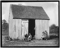 Small shack on Forsythe's Bog occupied by DeMarco family, 10 in the family living in this one room. Room is 10 feet x... - NARA - 523268.tif