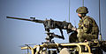 Soldier Manning .50 Cal Heavy Machine Gun on Patrol in Gereshk, Afghanistan MOD 45152675.jpg