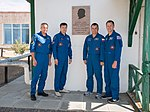 Soyuz MS-10 crew and backup crew in front of Korolev's cottage.jpg