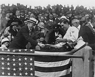 1924 World Series - Washington manager Bucky Harris presents President Calvin Coolidge with the baseball used to open the 1924 World Series