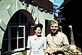 StateLibQld 2 319369 Teletype operator, Olga Honey, with assistant signal officer American Lieutenant Mark Muller outside Somerville House in Brisbane, 1942.jpg