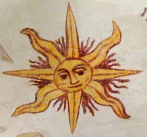 Solar symbol - Sun with a face and eight (alternating triangular and wavy) rays (fresco in Larbey, France, dated c. 1610)