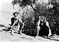 Swaziland; two young men seated, one of them smoking hemp Wellcome M0005729.jpg