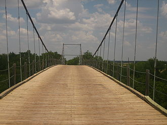 Texas Country Reporter - The Regency Suspension Bridge near Goldthwaite which Bob Phillips crosses in the introduction to his Texas Country Reporter television series