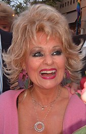 A smiling Tammy Faye Messner, with lots of makeup
