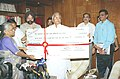 The IRCON International Ltd. officials paying Annual dividend cheque to the Union Minister for Railway Shri Lalu Prasad in New Delhi on October 05, 2004.jpg