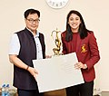 The Minister of State for Youth Affairs & Sports (Independent Charge) and Minority Affairs, Shri Kiren Rijiju conferring the Arjun Award to Ms. Smriti Mandhana (Cricket), in New Delhi on July 16, 2019.jpg