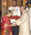 The President, Shri Pranab Mukherjee presenting the Padma Bhushan Award to Shri Cho S. Ramaswamy (posthumous), the award received by his wife, at the Civil Investiture Ceremony, at Rashtrapati Bhavan, in New Delhi.jpg