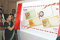 "The Secretary, Department of Posts, Smt. Jyotsna Diesh introducing the tear and water-resistant envelopes designed and made out specially for ""Raksha Bandhan"" in vibrant colours, in New Delhi on July 14, 2006.jpg"