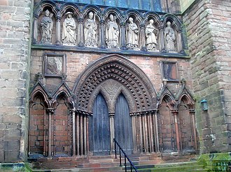 Roman cement - Above the ornate south doorway of Lichfield Cathedral stand seven figures carved in Roman cement.