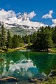 The monte Cervino when is reflected in the blue lake.jpg