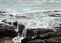 Tides over rocks at Rushikonda Beach.JPG