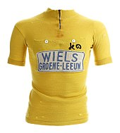 A woolen yellow jersey with writing on it