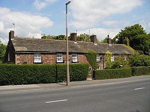 Middleton, Leeds - Rustic, brick-built cottages in Town Street known as Top of the town were built for the Brandlings' workers.