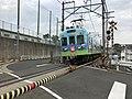 Train of Nishitetsu Kashii Line on south side of Kashii-Kaenmae Station.jpg