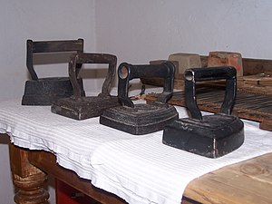 Clothes iron - Typical English irons of the 1800s (Collection Tranby House, Australia). The shape was used by Victorian antiquaries to describe a style of medieval shield, termed by analogy heater shield.