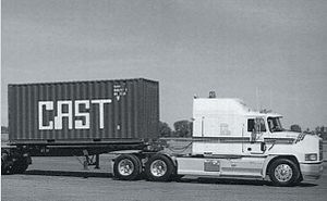 Transport truck and intermodal shipping container