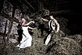 Trash the dress on a hayloft.jpg