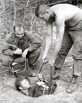 Tunnel rat - Tunnel rats preparing to place charges and make connections for detonation