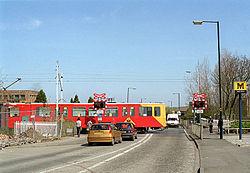 Tyne&Wear Metrotrain on level crossing wide angle.jpg