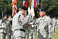 U.S. Army Lt. Gen. Jeffrey Talley, left, the chief of Army Reserve, and the commanding general of the U.S. Army Reserve Command promotes Col. Jose R. Burgos to the rank of brigadier general during his promotion 131214-A-CV700-005.jpg
