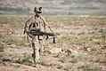 U.S. Army Pfc. Michael Andrade, an infantryman with Bravo Company, 3rd Battalion, 15th Infantry Regiment, 4th Infantry Brigade Combat Team, 3rd Infantry Division, carries an M240B machine gun while on a foot 130606-Z-QE403-298.jpg