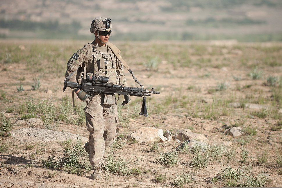 U.S. Army Pfc. Michael Andrade, an infantryman with Bravo Company, 3rd Battalion, 15th Infantry Regiment, 4th Infantry Brigade Combat Team, 3rd Infantry Division, carries an M240B machine gun while on a foot 130606-Z-QE403-298
