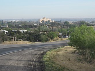 U.S. Route 87 - Route 87 as it approaches Big Spring, Texas, from the south. The Veterans Administration Hospital is shown in the background.
