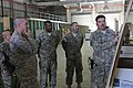 U.S. Marine Corps Sgt. Maj. Bryan B. Battaglia, second from left, the senior enlisted adviser to the Chairman of the Joint Chiefs of Staff, reviews a chart outlining retrograde operations at Bagram Airfield 130504-A-CL397-216.jpg